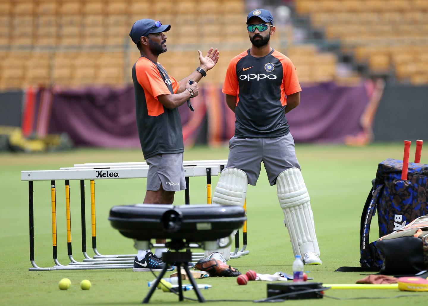 Indian cricket team captain Ajinkya Rahane, right, listens to fielding coach R. Sridhar during a training session ahead of one-off test match against Afghanistan in Bangalore, India, Wednesday, June 13, 2018. (AP Photo/Aijaz Rahi)