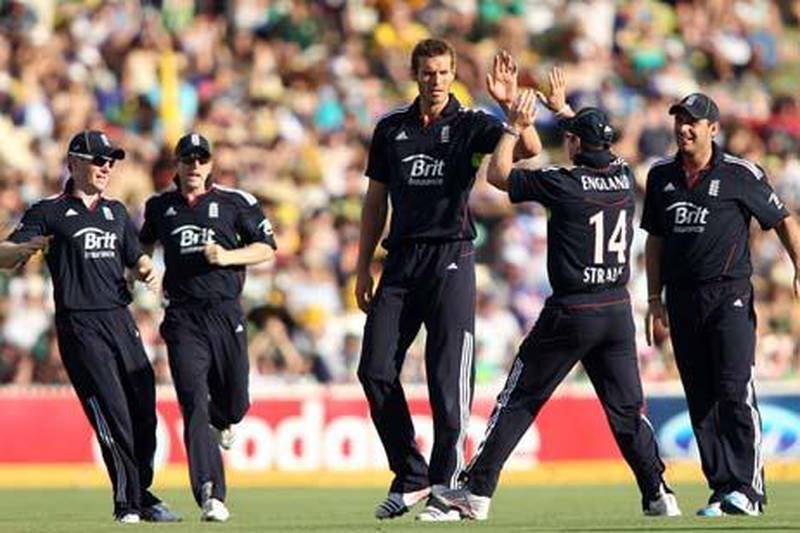 ADELAIDE, AUSTRALIA - JANUARY 26:  Chris Tremlett of England celebrates with team mates after getting the wicket of Brad Haddin of Australia during game four of the Commonwealth Bank One Day International Series between Australia and England at Adelaide Oval on January 26, 2011 in Adelaide, Australia.  (Photo by Morne de Klerk/Getty Images) *** Local Caption *** Chris Tremlett