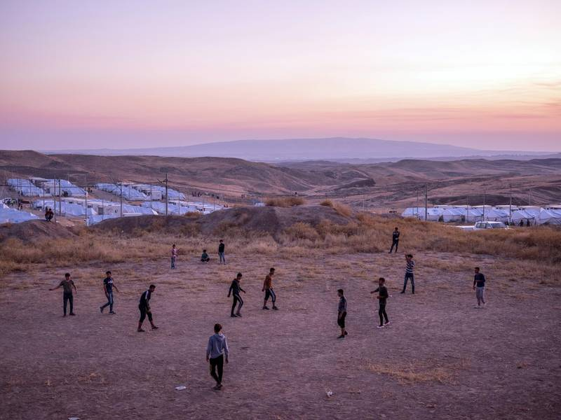 Bardarah Refugee Camp, Iraq. October 31, 2019.  Syrian Kurdish refugees play soccer inside the Bardarash refugee camp in Iraqi-Kurdistan.  According to the International Organization for Migration (IOM) as of November 6th more than 14,000 Syrian Kurds have fled their homes in Rojava, the Syrian-Kurdish enclave along the Turkish border in north-east Syria, and have taken refuge in camps inside Iraqi-Kurdistan. Bardarash camp houses over 12,000 Syrian-Kurdish refugees.