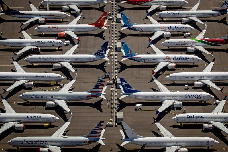 epa08892945 (FILE) - An aerial view of Boeing 737 Max 8 aircraft sitting parked at Boeing Field in Seattle, Washington, USA, 21 July 2019 (reissued 19 December 2020). According to US Senate investigators Boeing officials inappropriately coached test pilots during the 737 Max aircraft recertification process.  EPA/GARY HE   EDITORIAL USE ONLY  EDITORIAL USE ONLY *** Local Caption *** 55756093