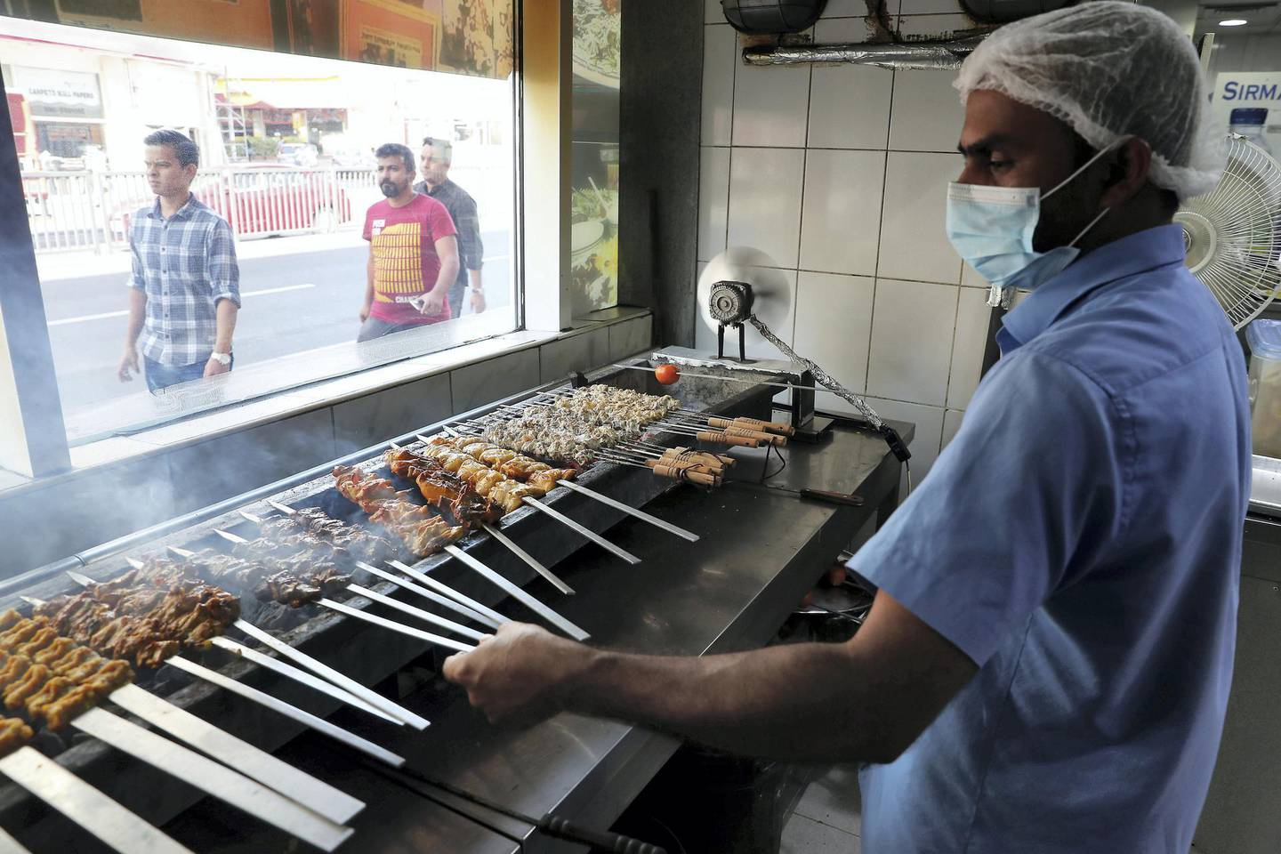 DUBAI , UNITED ARAB EMIRATES , January 9 ��� 2019 :- Worker preparing chicken and mutton kabad���s at the Ustad Special Kabab Iranian restaurant in Bur Dubai in Dubai. ( Pawan Singh / The National ) For News. Story by Nick Webster