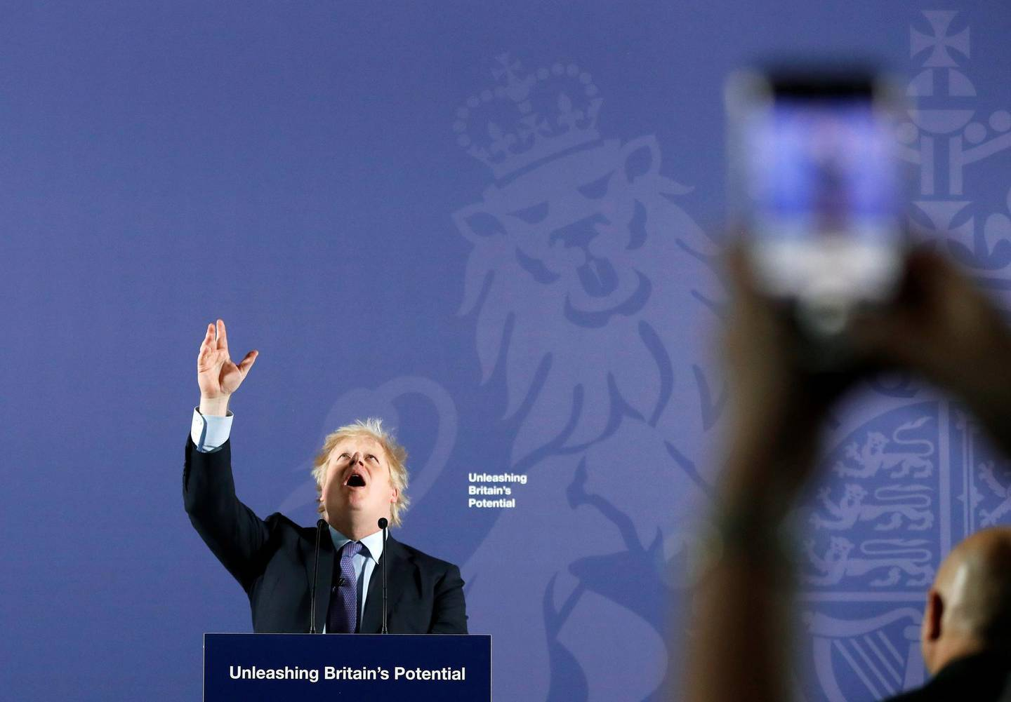 """TOPSHOT - Britain's Prime Minister Boris Johnson reacts as he delivers a speech at the Old Royal Naval College in Greenwich, south east London on February 3, 2020. Britain on Monday said it wanted a """"thriving trade and economic relationship"""" with the European Union, as it set out its position for future trade talks after it left the bloc. But Prime Minister Boris Johnson pledged: """"We will not engage in some cut-throat race to the bottom. We are not leaving the EU to undermine European standards. We will not engage in any kind of dumping, whether commercial, social or environmental."""" / AFP / POOL / AP / Frank Augstein"""