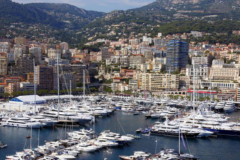 A picture taken on September 19, 2012 shows a general view in Monaco with yachts moored at Port Hercules during the 22th edition of the International Monaco Yacht Show. The Monaco Yacht Show is considered the most prestigious pleasure boat show in the world with the exhibition of 500 major companies in the luxury yachting and a hundred super and megayachts afloat. The event runs until September 22. AFP PHOTO / VALERY HACHE