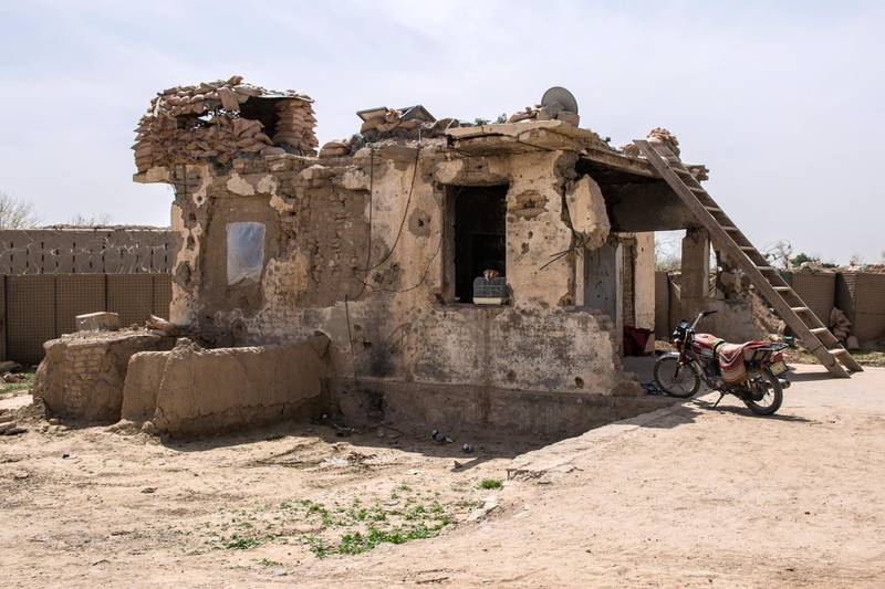Once a classroom, now the police dormitory at Assad Suri Primary School in Kandahar's Zhari District. Many of the buildings have been destroyed in airstrikes and by blasts.