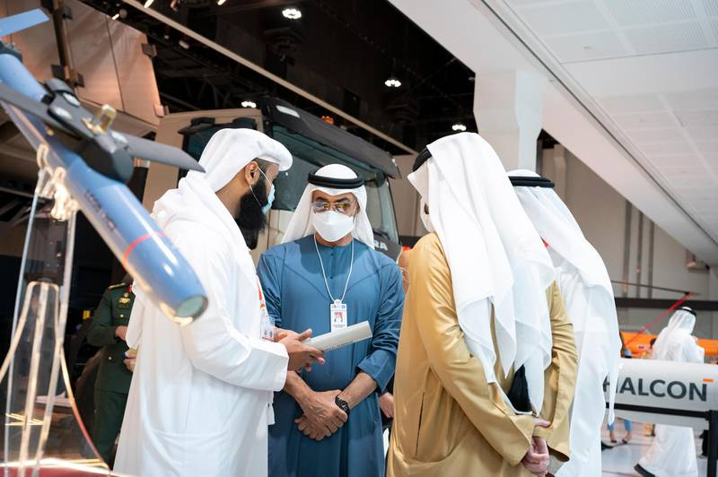 ABU DHABI, UNITED ARAB EMIRATES - February 22, 2021: HH Sheikh Mohamed bin Zayed Al Nahyan, Crown Prince of Abu Dhabi and Deputy Supreme Commander of the UAE Armed Forces (2nd L) tours the International Defence Exhibition and Conference (IDEX), at ADNEC.   ( Rashed Al Mansoori / Ministry of Presidential Affairs ) ---