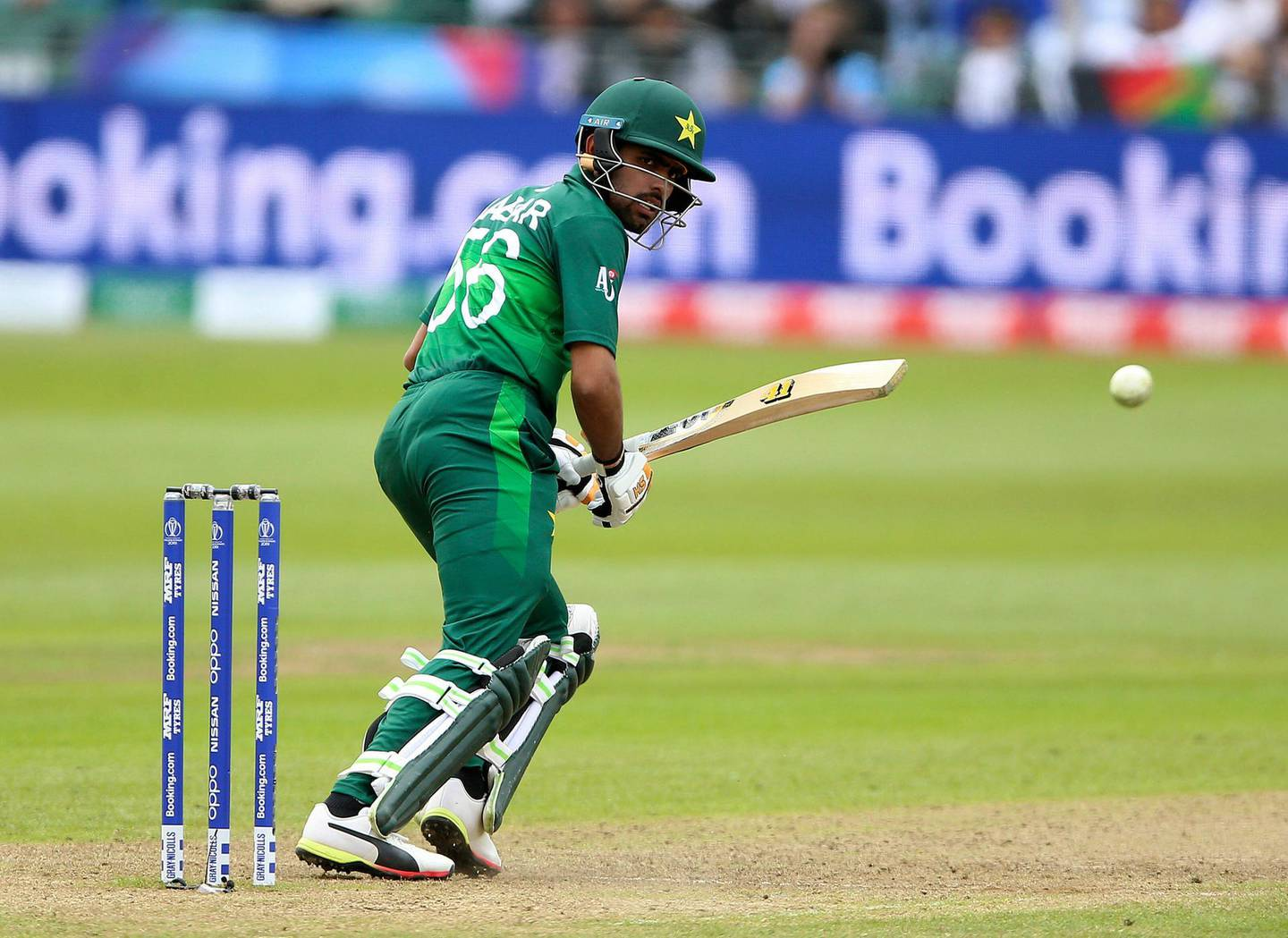 Pakistan's Babar Azam reaches his century during the ICC Cricket World Cup Warm up match between Pakistan and Afghanistan, at The Bristol County Ground, in Bristol, England, Friday May 24, 2019. (Nigel French/PA via AP)