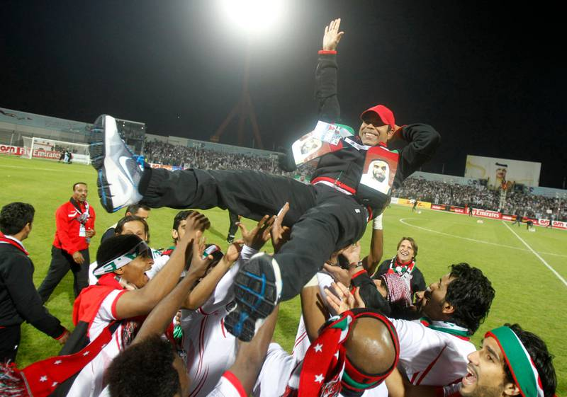 UAE's coach Mahdi Ali Hasan (C) celebrates with his team after winning their final game against Iraq at the Gulf Cup Tournament in Isa Town, January 18, 2013. REUTERS/Mohammed Dabbous (BAHRAIN - Tags: SPORT SOCCER) *** Local Caption ***  BAH12D_SOCCER-_0118_11.JPG