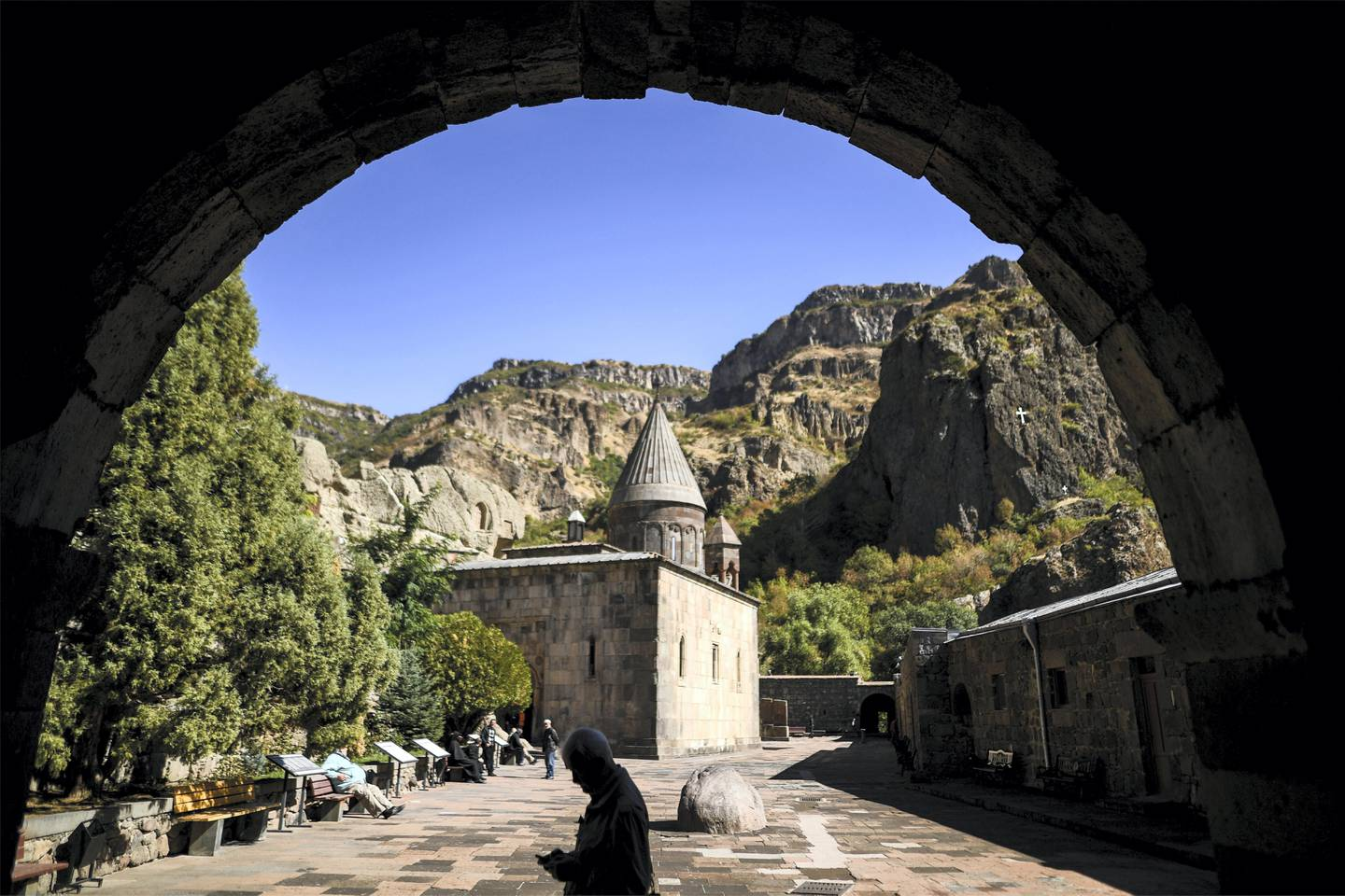 Tourists visit Geghard monastery, some 40kms from Yerevan on October 6, 2017. / AFP PHOTO / Kirill KUDRYAVTSEV
