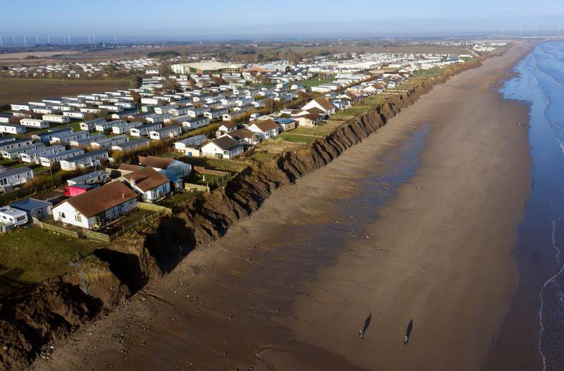 """Houses on the coastline in Skipsea, East Ridings of Yorkshire, where councillors are set to discuss the """"devastating"""" effect of erosion that will see dozens of people in Skipsea lose their homes to the sea on the fastest disappearing coastline in North West Europe. (Photo by Owen Humphreys/PA Images via Getty Images)"""