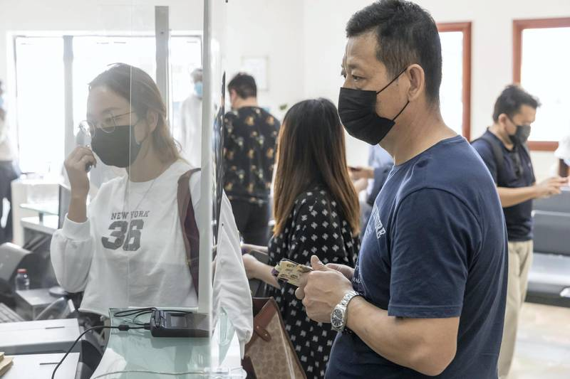 Covid-19 inoculations start in Dubai for Chinese nationals on visit visas to the UAE at the Al Safa Health Centre in Dubai on May 27th, 2021. Chinese Nationals wait for their vaccination shots as their appointments come up.Antonie Robertson / The National.Reporter: Ramola Talwar for National.
