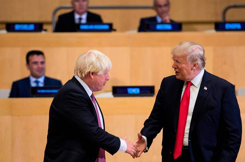(FILES) In this file photo taken on September 18, 2017 British Foreign Secretary Boris Johnson (L) and US President Donald Trump greet before a meeting on United Nations Reform at UN headquarters in New York on September 18, 2017. Prime Minister Boris Johnson makes his debut on the global stage at the G7 summit this weekend, August 24, 2019, where all eyes will be on his chumminess with US President Donald Trump.  / AFP / Brendan Smialowski