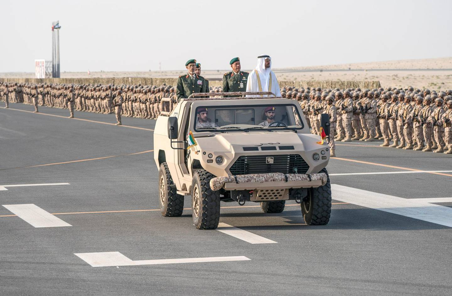 ZAYED MILITARY CITY, ABU DHABI, UNITED ARAB EMIRATES - November 28, 2017: HH Sheikh Mohamed bin Zayed Al Nahyan Crown Prince of Abu Dhabi Deputy Supreme Commander of the UAE Armed Forces (center R), inspects the cadets during a graduation ceremony for the 8th cohort of National Service recruits and the 6th cohort of National Service volunteers at Zayed Military City. Seen with HE Lt General Hamad Thani Al Romaithi, Chief of Staff UAE Armed Forces (center L) and Brigadier Faisal Mohamed Al Shehhi (C).  ( Hamad Al Kaabi / Crown Prince Court - Abu Dhabi ) —