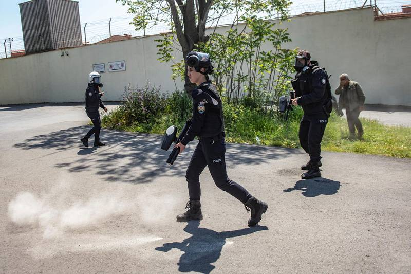 Turkish anti-riot police officers use teargas during a demonstration in solidarity with prisoners on hunger strike in front of the Bakerkoy prison in Istanbul on May 3, 2019. - Thousands of prisoners are on hunger strike in a bid to improve the detention conditions of Abdullah Ocalan, co-founder of the outlawed Kurdistan Workers' Party (PKK). Ocalan has been serving a life sentence for treason in an island prison near Istanbul since his capture in 1999. He has not had access to his lawyers since 2011. (Photo by Yasin AKGUL / AFP)