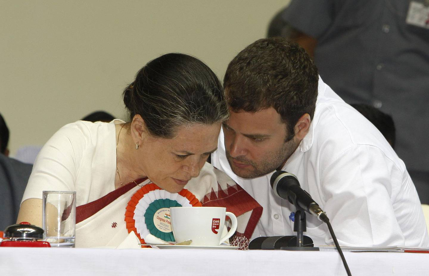 NEW DELHI, INDIA  NOVEMBER 02: Congress leaders Sonia Gandhi and son Rahul Gandhi exchange discussion during the All India Congress Committee (AICC) meet in New Delhi, on November 2, 2010.(Photo by Sipra Das/The India Today Group via Getty Images)