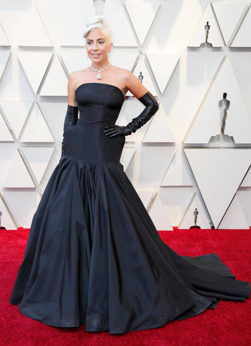 epa07394824 Lady Gaga arrives for the 91st annual Academy Awards ceremony at the Dolby Theatre in Hollywood, California, USA, 24 February 2019. Black dress by Alexander McQueen, diamond necklace featuring the Tiffany diamond by Tiffany & Co. The Oscars are presented for outstanding individual or collective efforts in 24 categories in filmmaking.  EPA-EFE/ETIENNE LAURENT