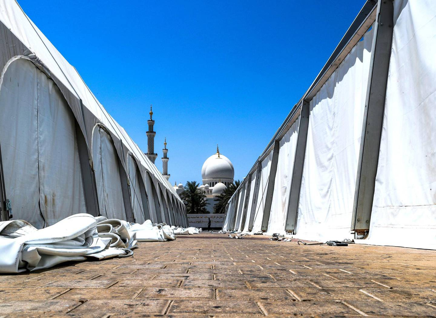 Abu Dhabi, U.A.E., June 18, 2018.  Sheikh Zayed Grand Mosque after Ramadan.  Workers disassemble the iftar tents at the North Parking Lot area of the Grand Mosque.Victor Besa / The NationalRequested by:   Olive Obina