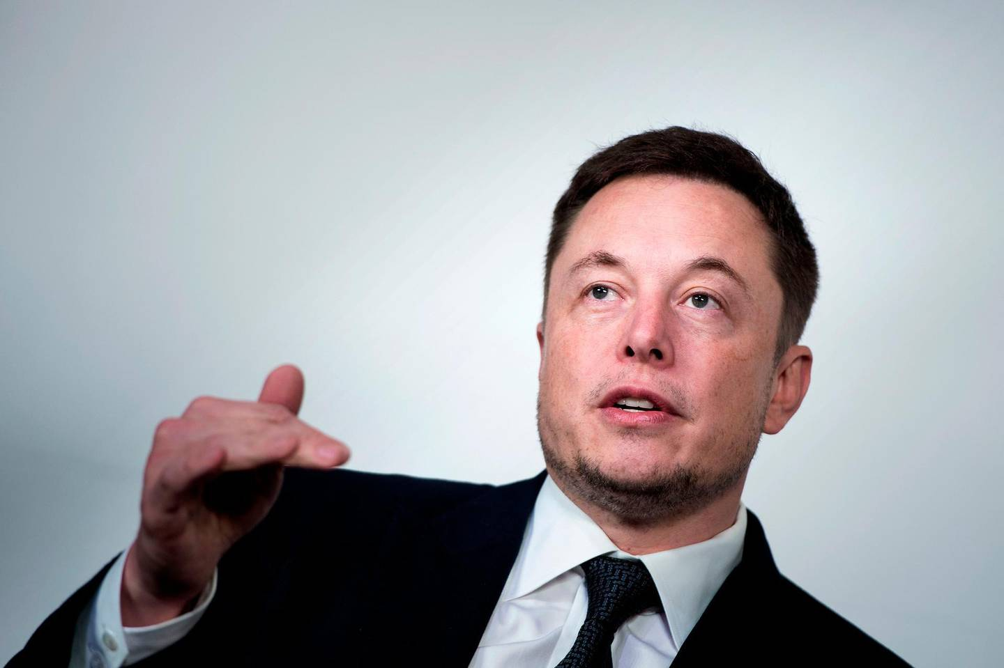 """(FILES) In this file photo taken on July 19, 2017 Elon Musk, CEO of SpaceX and Tesla, speaks during the International Space Station Research and Development Conference at the Omni Shoreham Hotel in Washington, DC. Tesla chief Elon Musk told employees May 14, 2018 the electric carmaker is being reorganized to speed up production of Model 3 vehicles -- a key to profitability at the fast-growing firm.""""To ensure that Tesla is well prepared for the future, we have been undertaking a thorough reorganization of our company,"""" the memo obtained by AFP said.""""As part of the reorg, we are flattening the management structure to improve communication, combining functions where sensible and trimming activities that are not vital to the success of our mission.""""  / AFP / Brendan Smialowski"""