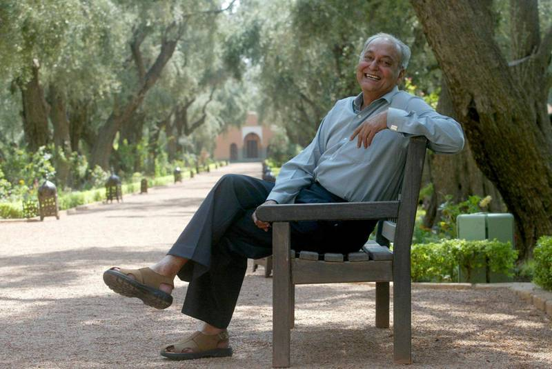 Indian actor Soumitra Chatterjee poses in the garden of Mamounia hotel 07 October 2003 during the third Marrakesh Film festival. AFP PHOTO/ABDELHAK SENNA (Photo by ABDELHAK SENNA / AFP)