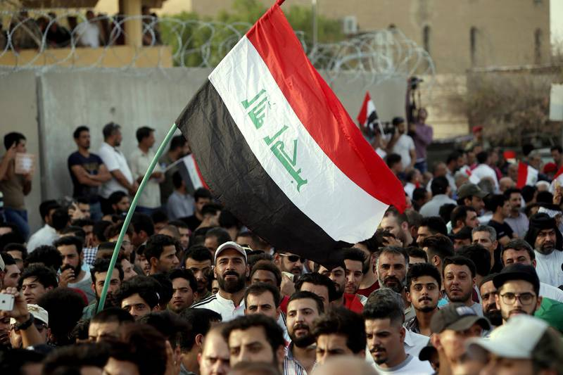 epa06914626 Iraqis chant slogans and carry banners during a demonstration in front of the headquarter of Basra governorate in Basra, 500 km southern Iraq, 27 July 2018.  According to media reports thousands of Iraqis protesters continue to hold protests in Baghdad and other provinces against unemployment, the rising cost of living, and lack of basic services.  EPA/HAIDER AL-ASSADEE