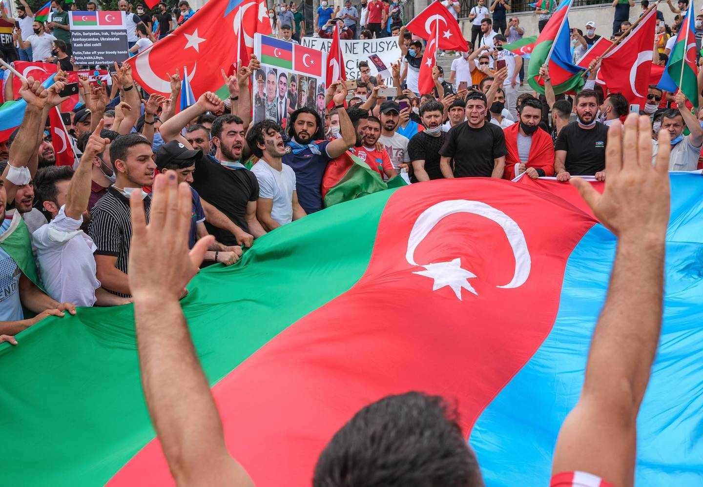 epa08554738 Ultra-nationalist Azerbaijani and Turkish people hold their national flags as they shouts slogans against Armenia in front of the Istanbul University in Istanbul, Turkey, 19 July 2020. The two neighbors have been locked in conflict over Nagorno-Karabakh, a region of Azerbaijan that has been under the control of ethnic Armenian forces backed by Armenia since a war there ended in 1994. At least 16 people, including an army general, were killed in border clashes between Armenia and Azerbaijan.  EPA/SEDAT SUNA