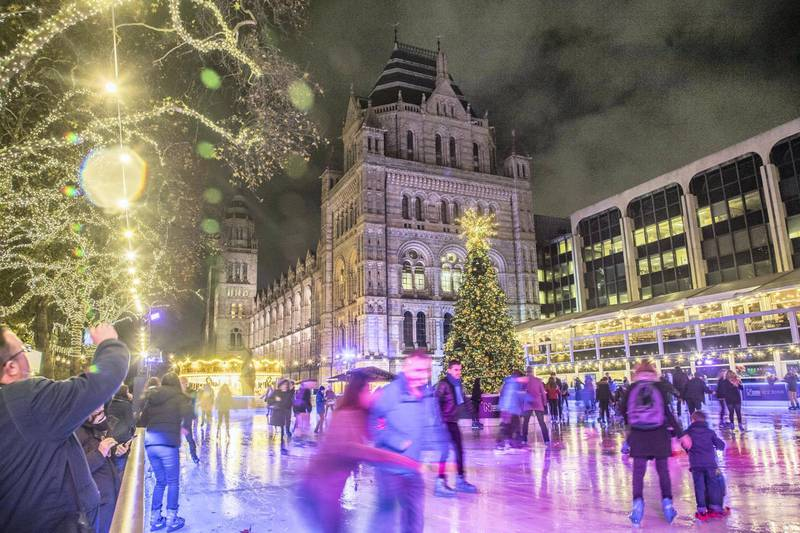 Christmas time decoration in London. Evening outside of the Natural History Museum of London with Christmas decoration, a carousel, an Ice Rink and a Christmas tree. (Photo by Nicolas Economou/NurPhoto via Getty Images)