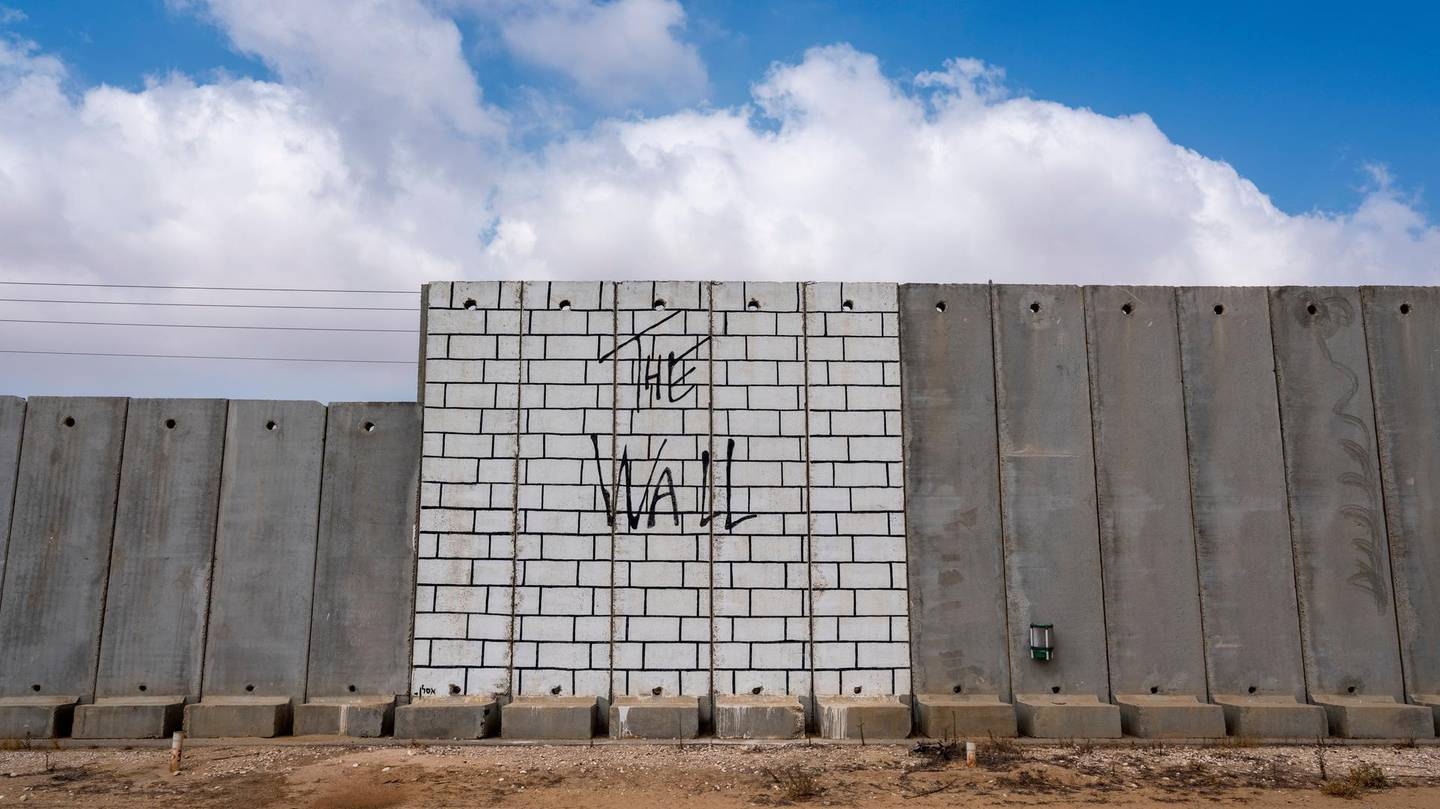 epa06925393 View of the Israeli separation fence, or wall, in Kibbutz Kerem Shalom, on the southernmost part of Israel that shares border with the Gaza Strip and Egypt, 03 August 2018. Much of the wall is covered in art works including this depiction of The Wall album cover by Pink Floyd, released in 1979 and one of the bestselling albums of all time.  EPA/JIM HOLLANDER