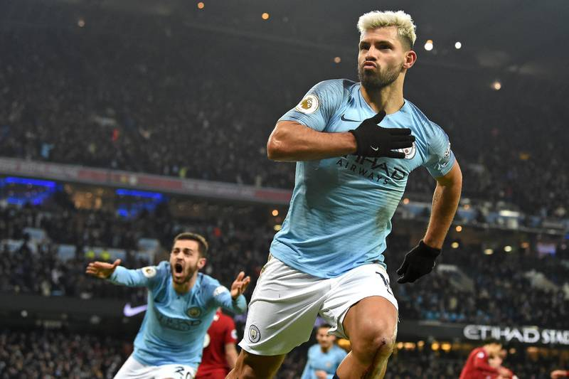 Manchester City's Argentinian striker Sergio Aguero celebrates after scoring the opening goal of the English Premier League football match between Manchester City and Liverpool at the Etihad Stadium in Manchester, north west England, on January 3, 2019. (Photo by Paul ELLIS / AFP) / RESTRICTED TO EDITORIAL USE. No use with unauthorized audio, video, data, fixture lists, club/league logos or 'live' services. Online in-match use limited to 120 images. An additional 40 images may be used in extra time. No video emulation. Social media in-match use limited to 120 images. An additional 40 images may be used in extra time. No use in betting publications, games or single club/league/player publications. /