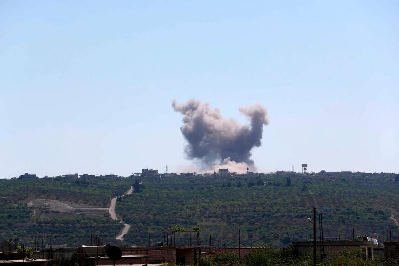 Smoke billows following bombardment by regime forces on the village of Ibdita in the Idlib province on May 4, 2019. The civil war in Syria has killed more than 370,000 people and displaced millions since it began in 2011 with anti-regime protests that sparked a devastating crackdown. / AFP / OMAR HAJ KADOUR