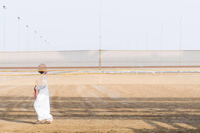 DUBAI, UNITED ARAB EMIRATES - Feb 15, 2018.  A man walks at the start line of Al Marmoum Race Track.  The fastest camels in the Gulf will compete for cash, swords, rifles and luxury vehicles totalling Dh95 million at the first annual Sheikh Hamdan Bin Mohammed Bin Rashid Al Maktoum Camel Race Festival in Dubai.   (Photo: Reem Mohammed/ The National)  Reporter: Section: NA