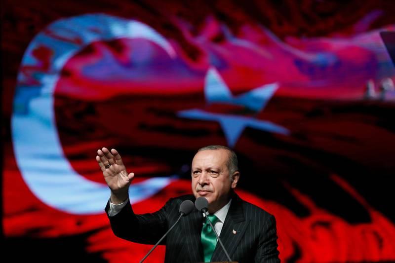 Turkey's President Recep Tayyip Erdogan gestures as he delivers a speech at a veterans' day event in Ankara, Turkey, Wednesday, Sept. 19, 2018.(Presidential Press Service via AP)