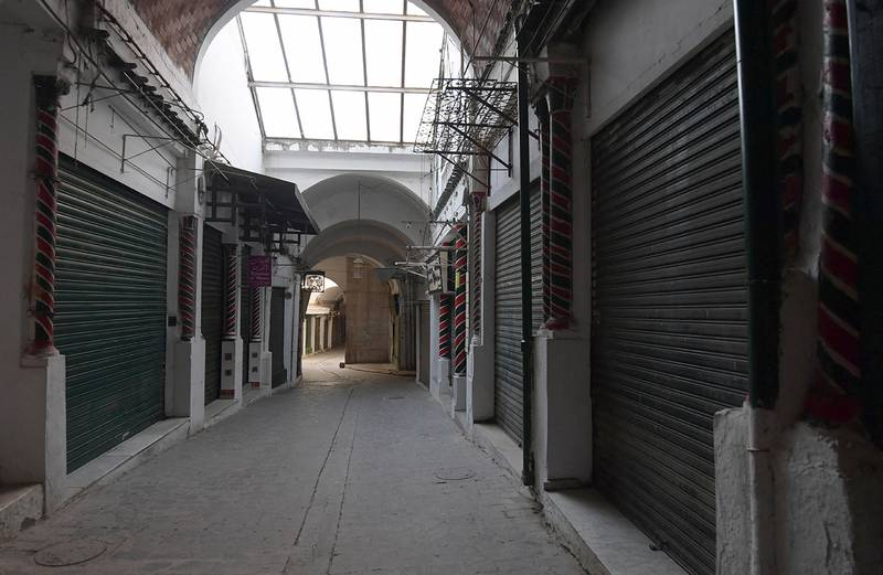 This picture taken on May 24, 2020 on the first day of Eid al-Fitr, the Muslim holiday which starts at the conclusion of the holy fasting month of Ramadan, shows a view of a deserted alley near the Zitouna mosque in the Medina (old town) of the Tunisian capital Tunis, at which shops have been closed for over two months due to the COVID-19 coronavirus pandemic. - Tunisia will reopen places of worship, restaurants and hotels from June 4, more than two months after closing them over the coronavirus pandemic. Travel between provinces remains forbidden and security checks will be increased during Eid al-Fitr, when people traditionally visit family. (Photo by FETHI BELAID / AFP)