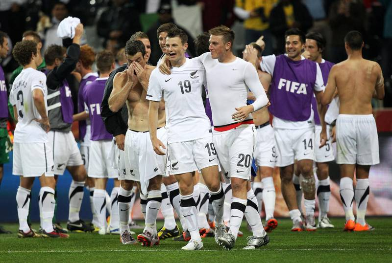 NELSPRUIT, SOUTH AFRICA - JUNE 20:  Tommy Smith and Chris Wood of New Zealand celebrate with team mates after a draw in the 2010 FIFA World Cup South Africa Group F match between Italy and New Zealand at the Mbombela Stadium on June 20, 2010 in Nelspruit, South Africa.  (Photo by Streeter Lecka/Getty Images)