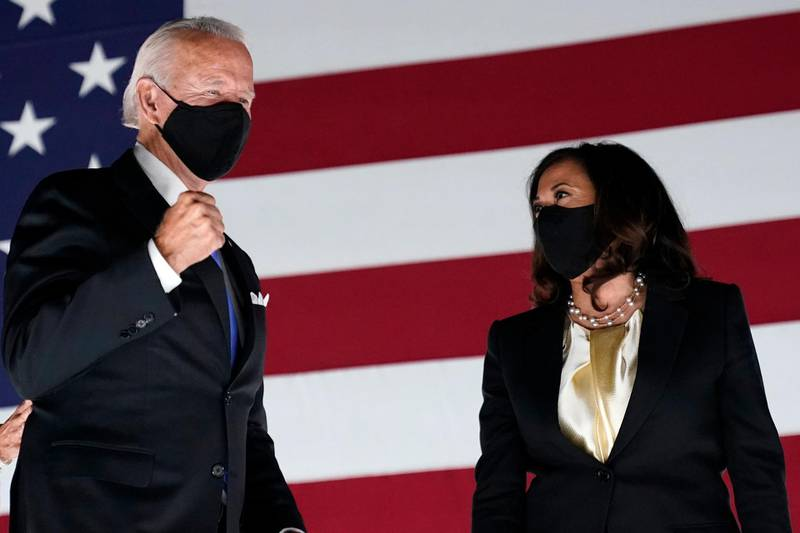 FILE- In this Aug. 20, 2020, file photo Democratic presidential candidate former Vice President Joe Biden pumps his fist on stage with his running mate Sen. Kamala Harris, D-Calif., during the fourth day of the Democratic National Convention at the Chase Center in Wilmington, Del. (AP Photo/Andrew Harnik, File)