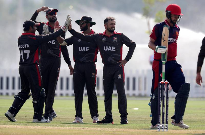 ABU DHABI , UNITED ARAB EMIRATES , October 22  – 2019 :- Rohan Mustafa of UAE ( center ) celebrating after taking the wicket of Ben Stevens ( right ) during the World Cup T20 Qualifiers between UAE vs Jersey held at Tolerance Oval cricket ground in Abu Dhabi.  ( Pawan Singh / The National )  For Sports. Story by Paul