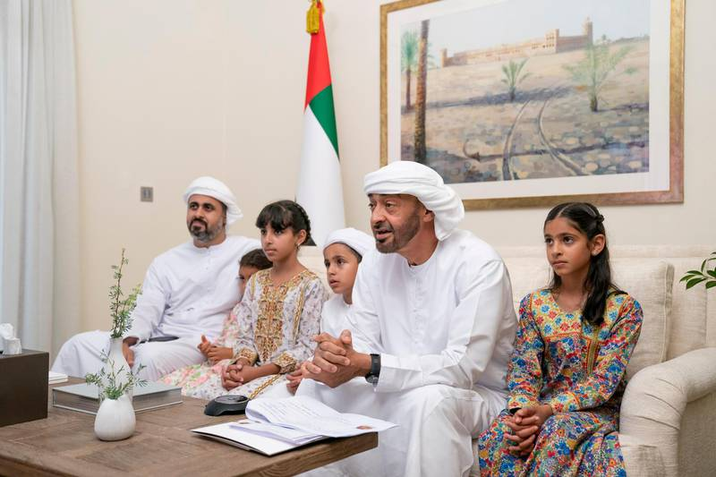 """ABU DHABI, UNITED ARAB EMIRATES - May 19, 2020: HH Sheikh Mohamed bin Zayed Al Nahyan, Crown Prince of Abu Dhabi and Deputy Supreme Commander of the UAE Armed Forces (2nd R), participates in an online lecture by HE Obaid Rashid Al Shamsi, Director-General of the National Emergency Crisis and Disaster Management Authority, titled """"Honoring Our Traditions, Valuing Our Safety"""". The lecture was broadcast on Al Emarat Channel as part of the Ramadan lecture series of Majlis Mohamed bin Zayed. Seen with HH Sheikha Shamma bint Khaled bin Mohamed bin Zayed Al Nahyan (R),  HH Sheikh Mohamed bin Nahyan bin Saif Al Nahyan (3rd R), HH Sheikha Fatima bint Mohamed bin Hamad bin Tahnoon Al Nahyan (4th R) and HH Sheikh Theyab bin Mohamed bin Zayed Al Nahyan, Abu Dhabi Executive Council member and Chairman of the abu Dhabi Crown Prince Court (CPC) (L).  ( Hamad Al Kaabi / Ministry of Presidential Affairs ) ---"""