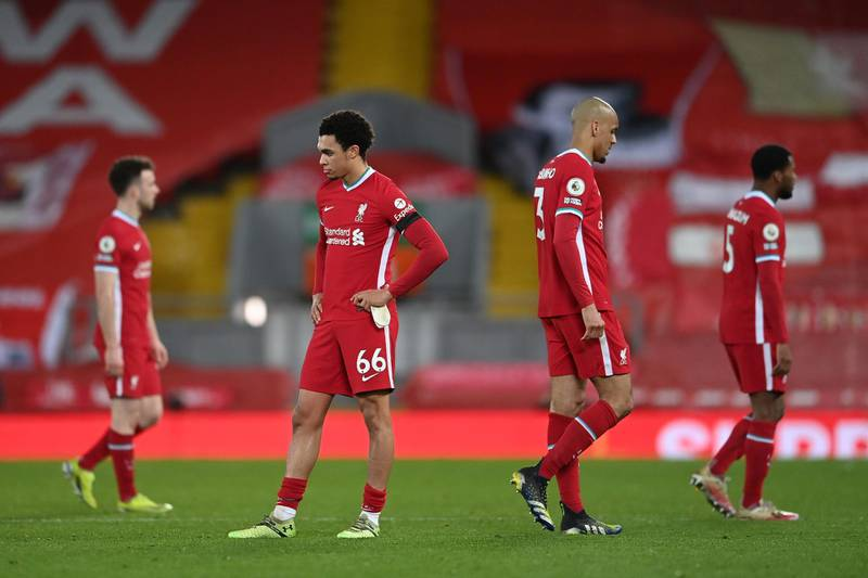 LIVERPOOL, ENGLAND - MARCH 04: Trent Alexander-Arnold of Liverpool and Fabinho of Liverpool look dejected following their team's defeat in the Premier League match between Liverpool and Chelsea at Anfield on March 04, 2021 in Liverpool, England. Sporting stadiums around the UK remain under strict restrictions due to the Coronavirus Pandemic as Government social distancing laws prohibit fans inside venues resulting in games being played behind closed doors. (Photo by Laurence Griffiths/Getty Images)