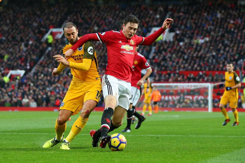 MANCHESTER, ENGLAND - NOVEMBER 25:  Glenn Murray of Brighton and Hove Albion and Victor Lindelof of Manchester United battle for the ball during the Premier League match between Manchester United and Brighton and Hove Albion at Old Trafford on November 25, 2017 in Manchester, England.  (Photo by Alex Livesey/Getty Images)
