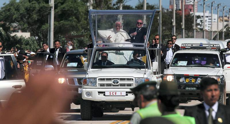 SANTA CRUZ, BOLIVIA - JULY 10:  Pope Francis (C) waves from the Popemobile on his way to the airport on July 10, 2015 in Santa Cruz, Bolivia. The Pope visited one of Bolivia's most notorious prisons earlier in the day. Pope Francis is now heading to Paraguay for the final leg of his three-country South American visit. The Pope held an open-air Mass in Santa Cruz yesterday.  (Photo by Mario Tama/Getty Images)