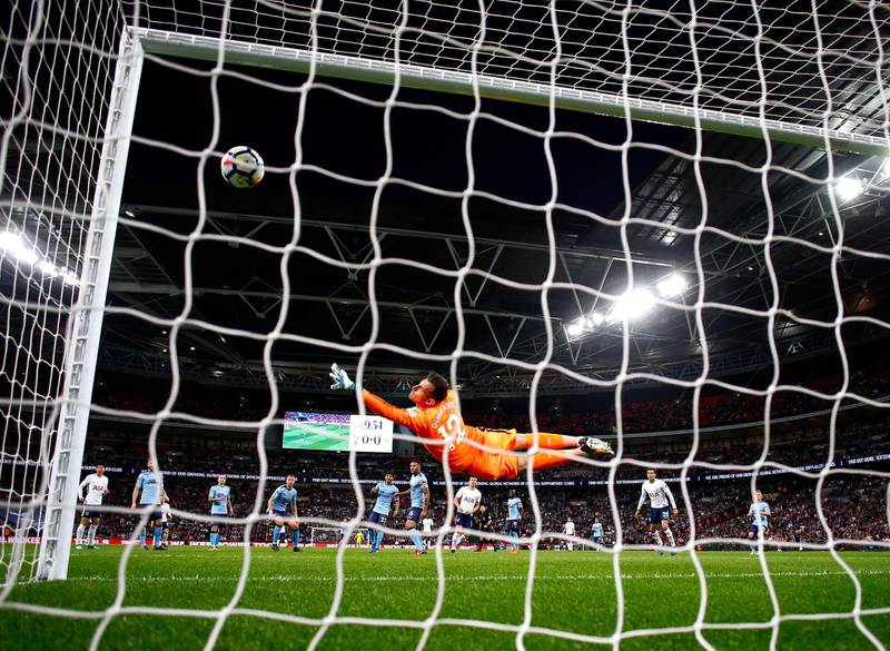 LONDON, ENGLAND - MAY 09:  Harry Kane of Spurs scores a goal past Martin Dubravka of Newcastle United during the Premier League match between Tottenham Hotspur and Newcastle United at Wembley Stadium on May 9, 2018 in London, England.  (Photo by Julian Finney/Getty Images)