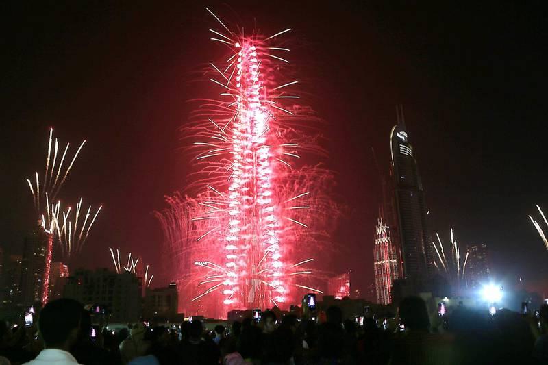 DUBAI, UNITED ARAB EMIRATES - Fireworks explode over Downtown Dubai to ring in 2017 in Dubai.  Satish Kumar /The National *** Local Caption ***  na01ja-pg1-BurjKhalifa.jpg