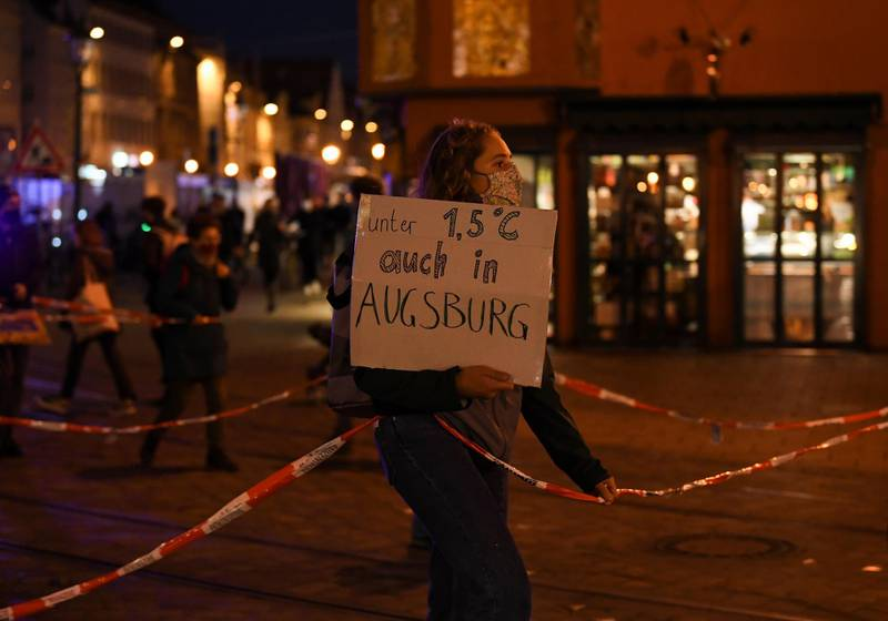 A person holds a sign during a demonstration against climate change, amidst the spread of the coronavirus disease (COVID-19) In Augsburg, Germany, October 30, 2020. REUTERS/Andreas Gebert