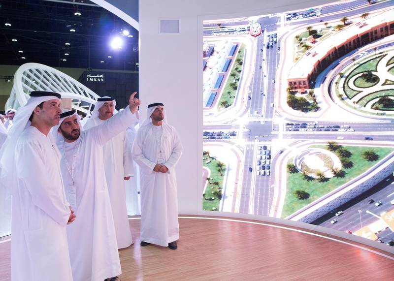 ABU DHABI, UNITED ARAB EMIRATES - April 16, 2019: HH Sheikh Hazza bin Zayed Al Nahyan, Vice Chairman of the Abu Dhabi Executive Council (L), attends the opening of Cityscape Abu Dhabi, at Abu Dhabi National Exhibition Centre (ADNEC). Seen with HE Falah Mohamed Al Ahbabi, Chairman of the Department of Urban Planning and Municipalities and Abu Dhabi Executive Council Member (R).   ( Mohammed Al Blooshi for Ministry of Presidential Affairs ) ---