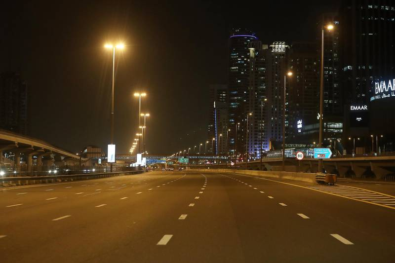 DUBAI, UNITED ARAB EMIRATES , April 05 – 2020 :- View of the almost empty Sheikh Zayed road in Dubai. Dubai is conducting 24 hours sterilisation programme across all areas and communities in the Emirate and told residents to stay at home. UAE government told residents to wear face mask and gloves all the times outside the home. Dubai Metro and Tram shut down until further notice. (Pawan Singh / The National) For News/Online/Instagram.