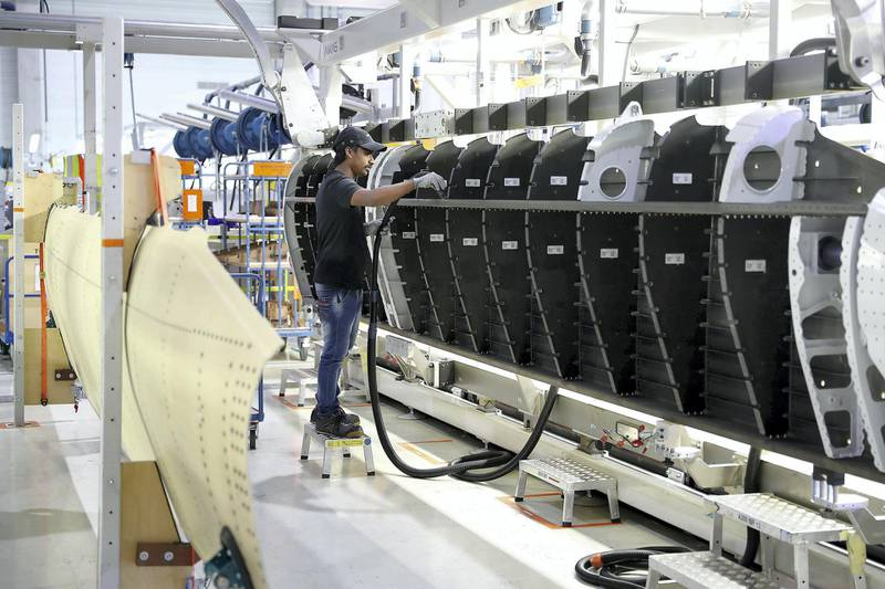 AL AIN , UNITED ARAB EMIRATES , JULY 2 – 2018 :- Worker working on the parts for Airbus and Boeing in the Assembly section at the Strata Manufacturing facility in Al Ain. ( Pawan Singh / The National )  For News. Story by John Dennehy