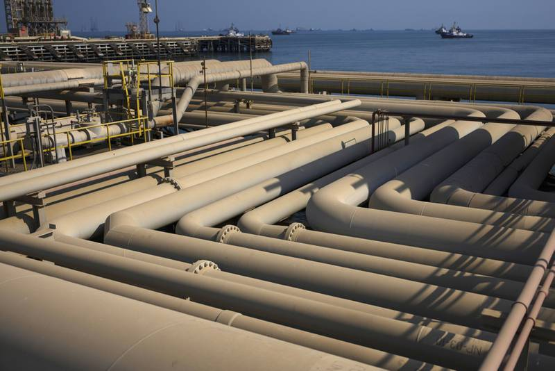 Oil pipelines sit on the quayside beside the Arabian Sea at the North Pier terminal in Saudi Aramco's Ras Tanura oil refinery and oil terminal in Ras Tanura, Saudi Arabia, on Monday, Oct. 1, 2018. Saudi Arabiais seeking to transform its crude-dependent economy by developing new industries, and is pushing into petrochemicals as a way to earn more from its energy deposits. Photographer: Simon Dawson/Bloomberg