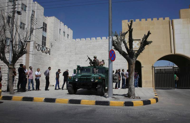 Men line up outside the Jordan state security court in Amman, Jordan on Sun. June 18, 2017. The fathers of two of the three American soldiers who were shot dead at a Jordanian military base are attending the latest hearing in the trial of the Jordanian serviceman accused of killing them. Brian McEnroe and James Moriarty traveled to Amman to attend Sunday's hearing in a state security court. (AP Photo/Sam McNeil)