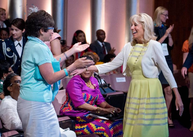 epa04343093 Dr. Jill Biden, (R) is welcomed by Senior advisor to US President Barack Obama, Valerie Jarrett, as she arrives for the plenary session entitled 'Investing in our Future' at the US-Africa Leaders Summit in Washington DC, USA, 06 August 2014.  EPA/Ron Sachs / POOL