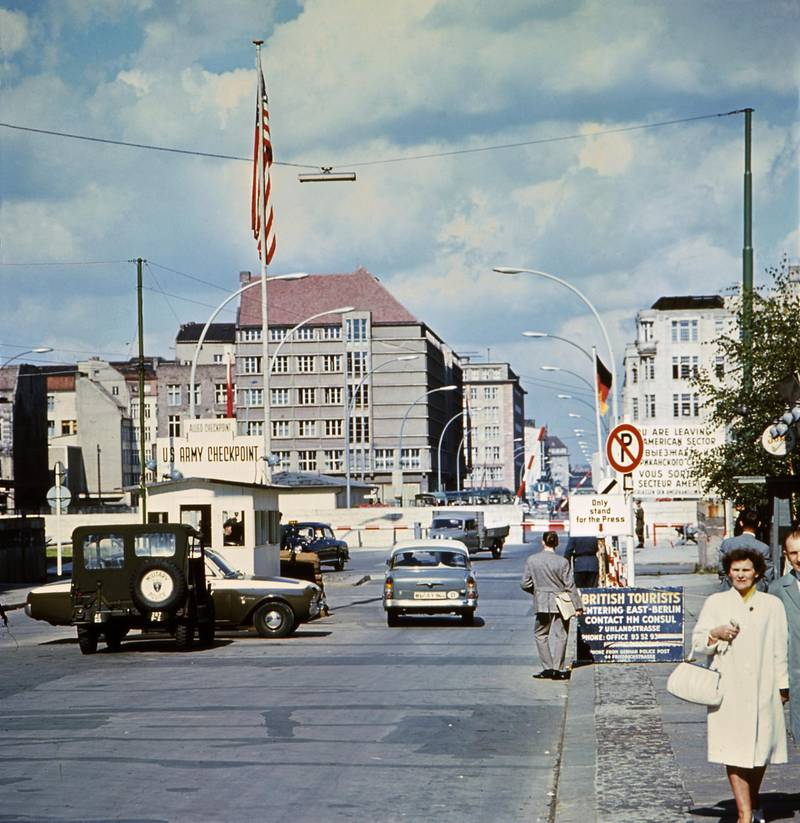 Picture taken in June 1968 of the famous Checkpoint Charlie crossing point, marking the border between East (Soviet sector) and West Berlin (American sector). The Berlin wall built by the East German government to seal off East Berlin from the part of the city occupied by the three main western powers (USA, Great Britain and France), and to prevent mass illegal emigration to the West. The wall, built along the border between German Democratic Republic (GDR) and Federal Republic of Germany, was the scene of the shooting of many East Germans who tried to escape from GDR. The two countries remained divided until November 1989 when the wall was unexpectedly opened following increased pressure for political reform in GDR. (Photo by AFP)