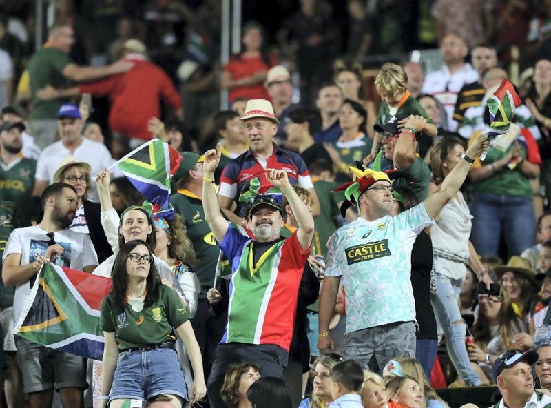 Dubai, United Arab Emirates - December 07, 2019: South Africa fans celebrate during the game between New Zealand and South Africa in the mens final at the HSBC rugby sevens series 2020. Saturday, December 7th, 2019. The Sevens, Dubai. Chris Whiteoak / The National