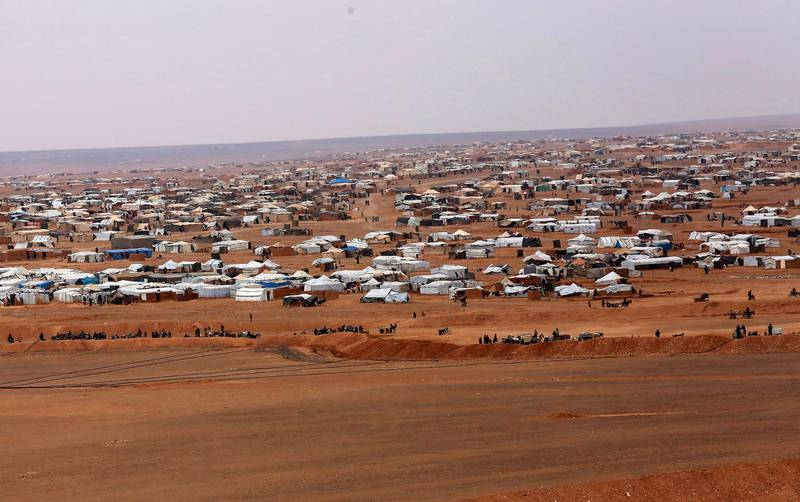 FILE - This file picture taken Tuesday, Feb. 14, 2017, shows an overview of the informal Rukban camp, between the Jordan and Syria borders. The United Nations' children agency says on Wednesday, Oct. 10, 2018 that two children have died in a desert camp for displaced people along the Syria-Jordan border. The agency says a 5-day-old boy and a 4-month-old girl died in the squalid Rukban camp, which houses over 40,000 people. (AP Photo/ Raad Adayleh, File)